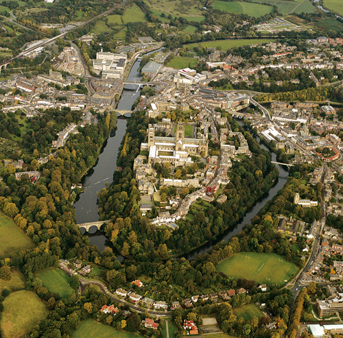 Durham World Heritage Site, as seen from the air. The Durham peninsula is a natural defensive site. Only the peninsula neck was vulnerable, hence the construction of the strongest Castle defenses there. The steep river banks made the rest of the peninsula impossible to attack.