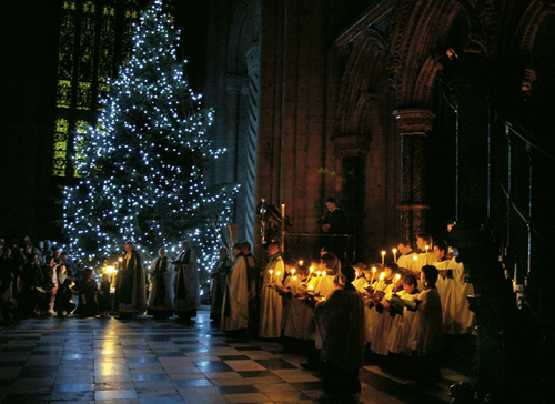 A candle-lit carol-service around the Christmas tree.
