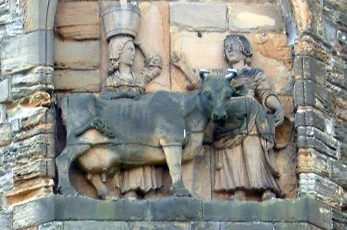 The story of the Dun Cow, as depicted in an eighteenth century panel on the north facade of Durham Cathedral.
