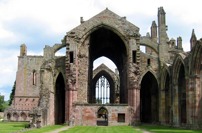Cuthbert's Melrose Abbey was raided in 839 and then fell into ruin. It was refounded as a Cistercian abbey in 1136, three miles from its original site, because the land was better for farming there. It was destroyed and reconstructed several times, but alas, stands in ruin today.