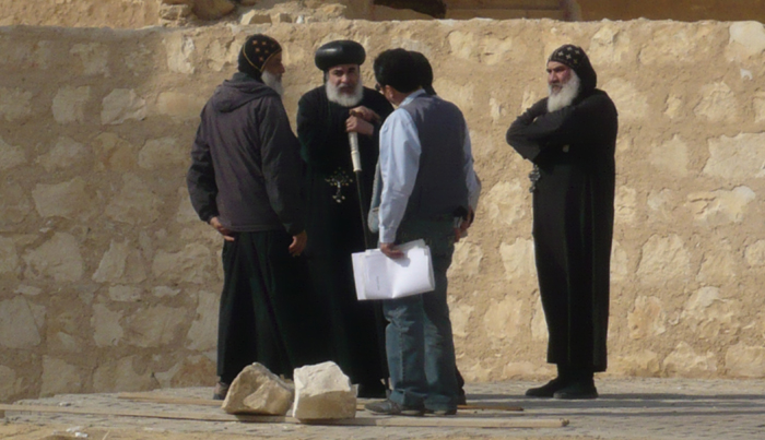 Given their importance and longevity, building projects usually received at least some sort of input from the head of the religious establishment. This is true even today. Seen here, the Bishop of St Anthony's Monastery in Egypt discusses the construction of a new building on-site with his architects and two senior monks.