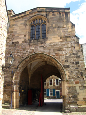 The gateway to the college. Above the entrance is a chapel, which was a common arrangement in medieval priories.
