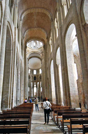 The Cathedral of St Foy, Conques, 1087-1107 France, demonstrates the limitations of the groin vaults used to roof the nave. The nave is extremely narrow, almost like a tunnel -- it was the pointed arches and rib vaults used at Durham that were to enable later buildings to solve this problem - allowing for vaults that spanned much greater widths and soared much higher.
