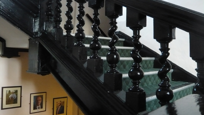 The seventeenth-century staircase of the main building of St Cuthbert's Society.