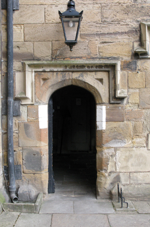 One of the doorways in the courtyard of Durham Castle, showing the white paint, useful during black-outs, that has been periodically repainted since World War II.