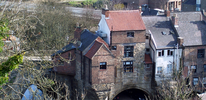 View of the east end of Elvet Bridge, showing the buildings constructed on it. The building to the furthest left still retains the remains of a chapel dedicated to St Andrew.