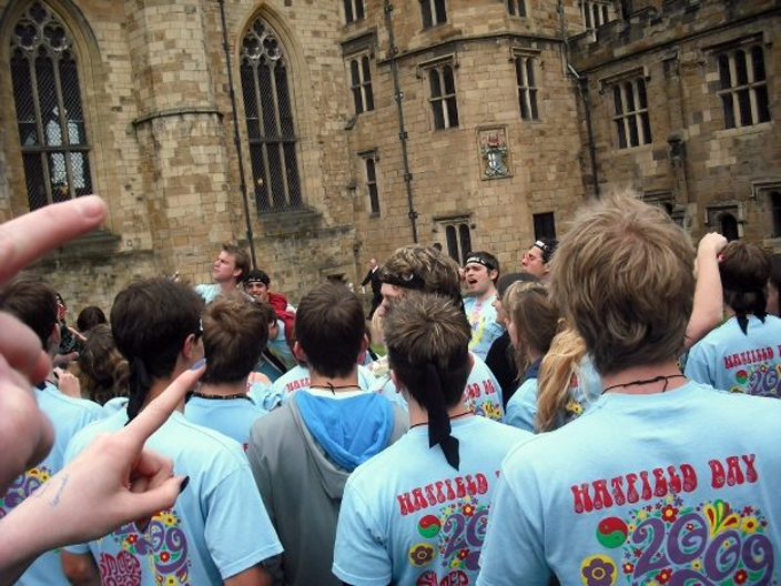Hatfield students singing their college songs in the Castle Courtyard - an example of the friendly rivalry that exists between colleges.