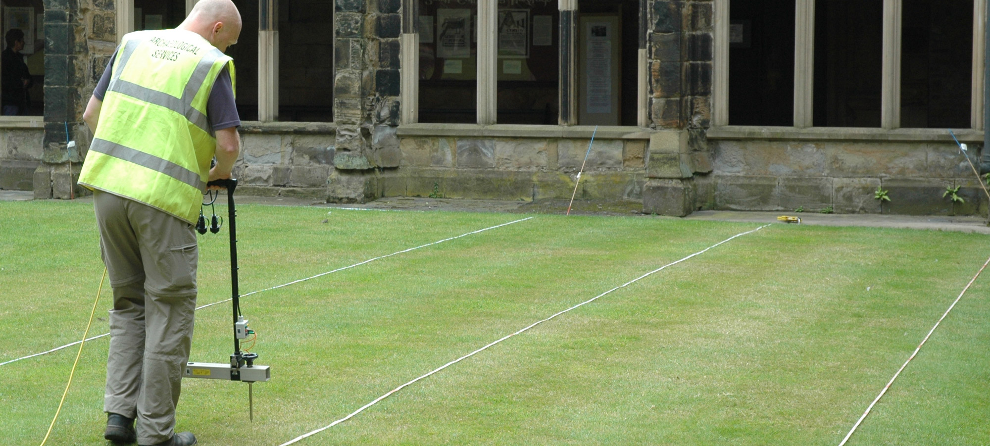 Photograph of a geophysical survey being undertaken in the cloister at Durham Cathedral