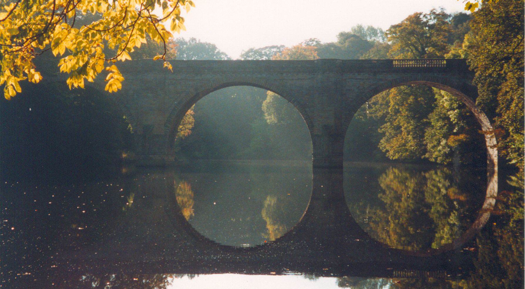 Prebends' Bridge reflected in the River Wear with autumnal trees
