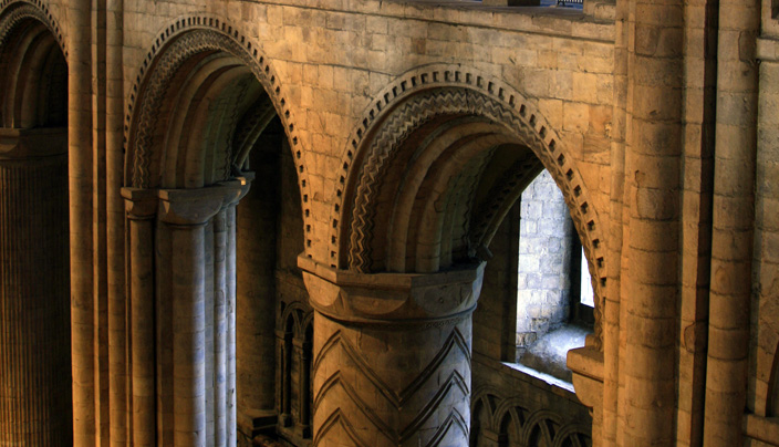 The Norman section of Durham Cathedral is characterised by its solidness, most notable in its robust columns and small, round-arched windows. In the two centuries that followed, architectural technology and consequently architectural conventions evolved greatly, making the Chapel of the Nine Altars, seen below, possible.