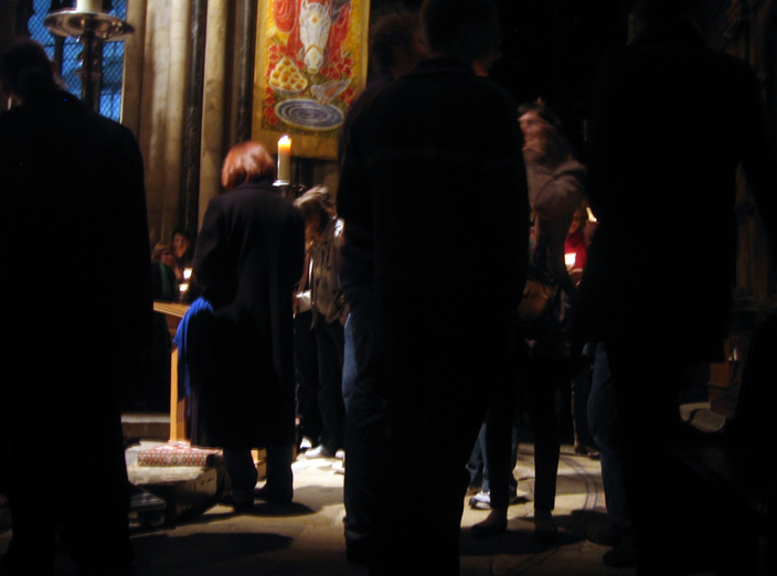 Visitors congregate silently at the Shrine of St Cuthbert.