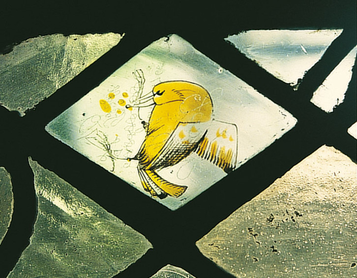 Detail of the stained glass window in the Chapter House. Some fragments of medieval stained glass still exist in Durham Cathedral and have been incorporated into later windows. This is one such example.