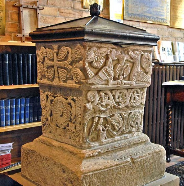 The Norman font at St. Bridget's Church in BrideKirk, a good example of Anglo-Norman stone carving