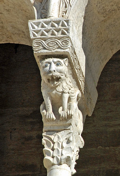 Carved stone lion from an arcade in Bitonto Cathedral, Italy. Mythical creatures and fearsome beasts, such as this lion, appeared frequently in Romanesque architecture.