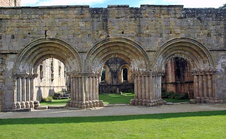 View of Fountains Abbey in North Yorkshire showing the round arches typical of Romanesque architecture