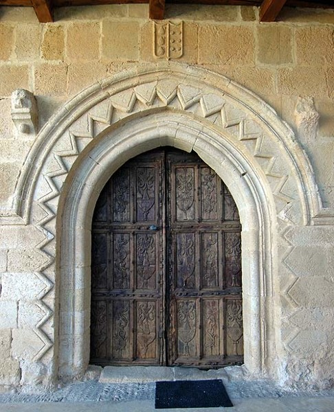 An archway with a zigzag (chevron) pattern, at the convent of Gradefes in Spain. The chevron is used to great effect in Durham Cathedral, especially in the late twelfth century Gallilee Chapel