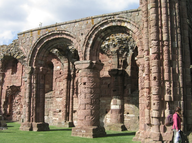 View of the ruins of Lindisfarne Priory. The arcades, especially the pillars with a chevron or zigzag design are like a scaled-down version of those of Durham Cathedral. This is hardly surprising: The priory was refounded in the early twelfth century by the Durham-based community of St Cuthbert, after the building of the Cathedral. It is possible that the same masons worked on both buildings.