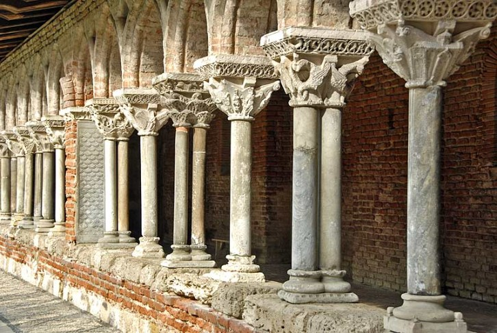 Detail of the cloisters at the Abbey of St Pierre de Moissac, France. Completed circa 1100. The capitals of the columns in the cloisters at Moissac are among the earliest and finest examples of figural stone carving in Romanesque architecture. They narrowly escaped demolition at the end of the nineteenth century to make way for a railway line!