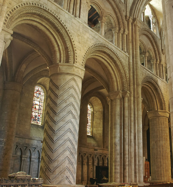 The geometric designs carved in the stone pillars of Durham Cathedral were common in Norman architecture. The specific details of these suggest that the masons who carved them also worked on Lindisfarne Priory to the North of Durham.