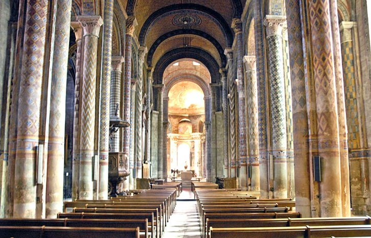 The nave of Notre Dame la Grande, Poitiers, France, 12th century. It is often difficult to imagine that the interior of Romanesque churches would have originally been quite colourful. The geometric designs still seen at Poitiers, however, give us a good sense of what Durham Cathedral and the Norman Chapel at Durham Castle would have looked like.