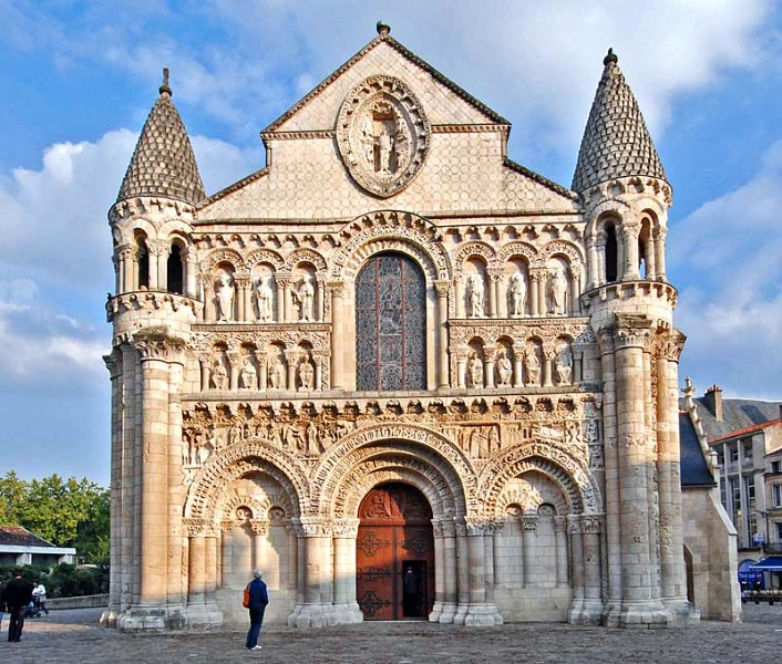 The facade of Notre Dame la Grande, Poitiers, France, 12th century. This facade is a good example of Romanesque architecture in that is very solid, makes use of rows of rounded arches in which figural sculpture is to be found, and features geometric patterns as well.