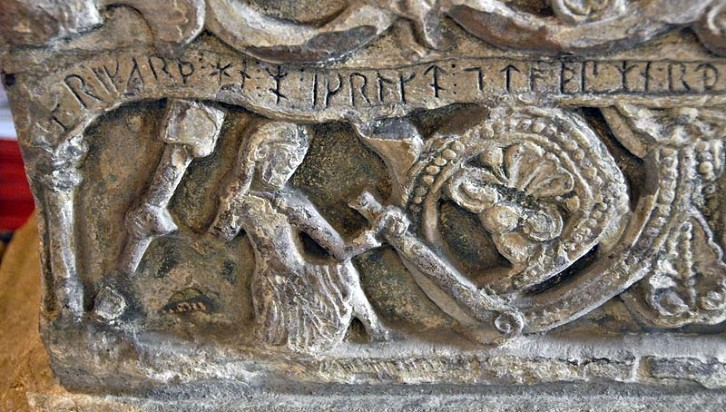 Detail of a stone font dating from circa 1150 and depicting its maker Richard of Durham. In St. Bridget's Church, Bridekirk.