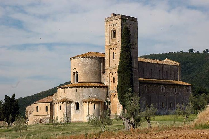 Exterior view of the abbey of Sant Antimo, Tuscany, Italy, 1120. This Benedictine abbey is a text-book example of Romanesque architecture, with its square tower, solid construction, and small, round-arched windows. The abbey here was the most important foundation in Tuscany. It had imperial connections, was on the route to Rome, and had extensive landholdings. It has an interesting historic parallel to Durham. The abbot was so powerful that he held the title of Earl Palatine, and had similar secular authority as the Prince Bishops of Durham.