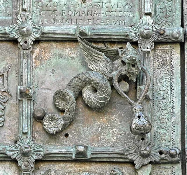 Troia Cathedral Doorknocker. Part of an elaborate bronze door made in 1119, Troia Cathedral, Italy. Unlike the Sanctuary Knocker at Durham Cathedral, the dragon here looks almost friendly. In terms of their concept though, the two knockers have something in common.