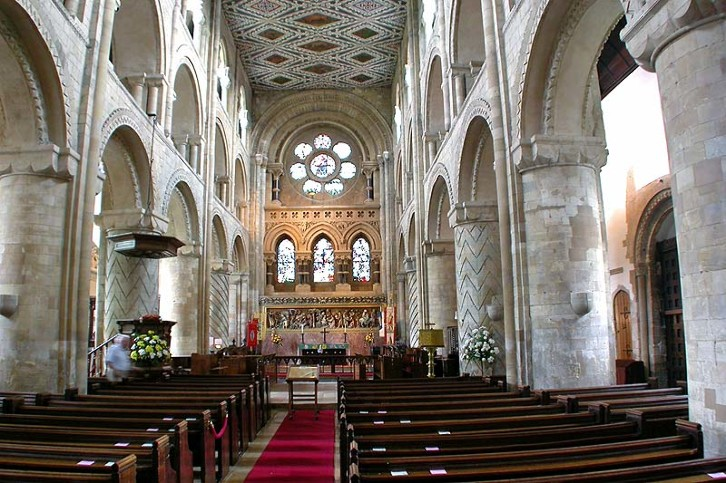 View of the nave of Waltham Abbey, England, mid 12th century. The abbey is contemporary with the nave of Durham Cathedral, and in fact looks quite similar. The stone for the construction was probably imported from Caen in Normandy, a common practise in Norman times, (though not the case in Durham, where the stone was local).
