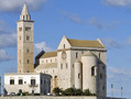 Exterior view of Trani Cathedral, Italy, 1199 onwards. The fact that Romanesque buildings tended to have small windows is very clear in a building like this, which looks almost defensive.