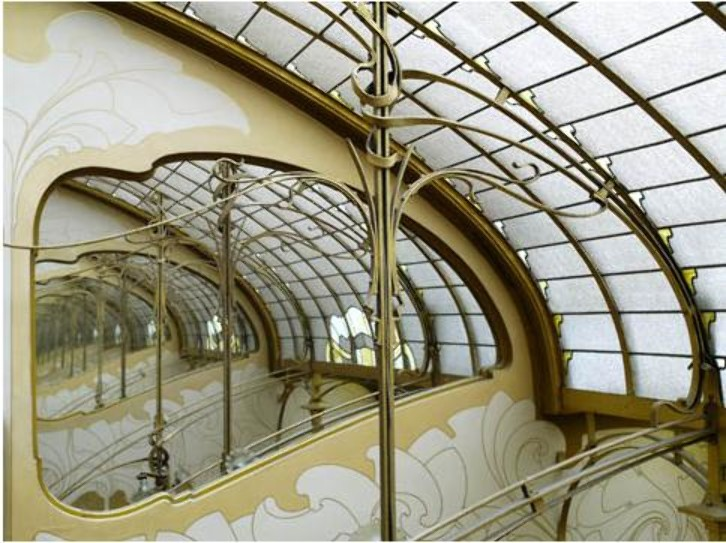The fluid lines of the Art Nouveau style are exemplified in four late 19th century Brussels townhouses designed by Victor Horta. Horta's buildings are characterised by their open plan, the diffusion of light, and the brilliant joining of the curved lines of decoration with the structure of the building.
