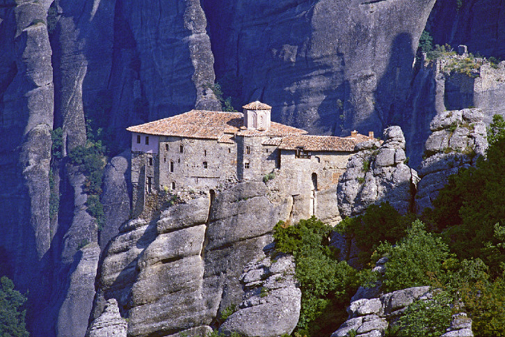 The meteora are enormous masses of sandstone shaped by seismic activity into free-standing columns of rock. The name